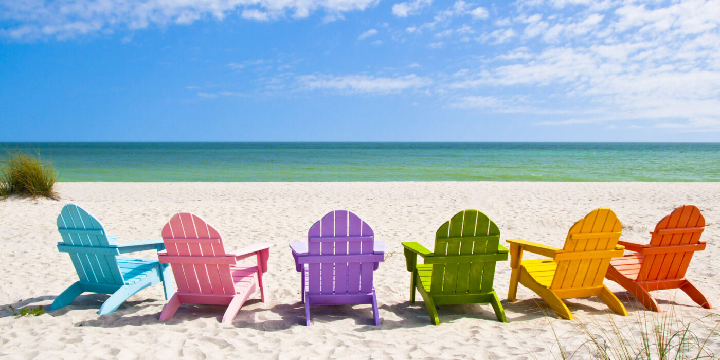 28950860 - adirondack beach chairs on a sun beach in front of a holiday vacation travel house
